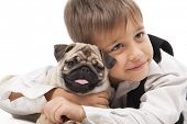 Little boy and the Pug-dog isolated on a white background
