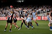 MELBOURNE - APRIL 2: Collingwood's Darren Jolly stretches for the ball in a ruck contest in their wi