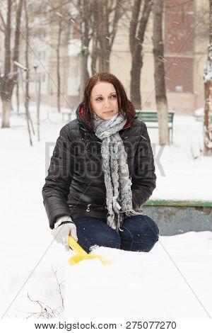 Happy Girl Shovels Away Snow
