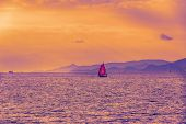 Beautiful Sunset. Sailing Boat With A Red Sail On The Calm Sea. Athens, Greece poster