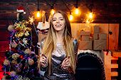 Sparkles Party, Bengal Lights. Christmas Interior. Funny Christmas Girl. Winter Holidays And People  poster