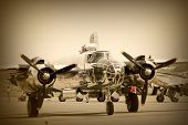 A wide vintage aeroplane in sepia color tone