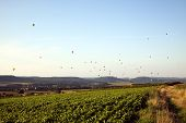 large group of hot air balloons above  the Mosel valley near Trier