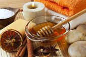 aromatic ingredients for a spa treatment - cinnamon, star anise, orange, honey, salt, arranged with