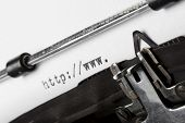 beginning of URL written on old typewriter, tilted view, shallow depth of field