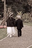 Boy And Girl Walking Hand In Hand