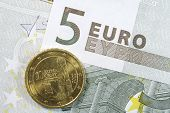 Five Euro Note and Ten Cent Coin