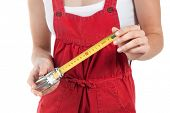 Female handworker with tape measure, isolated on white