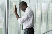 Businessman in his office, looking depressed