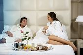 stock photo of bed breakfast  - Relaxed Couple in Bed - JPG