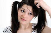 stock photo of dandruff  - portrait of worried young woman touch hair - JPG