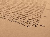 sepia toned old open book page with ancient latin text of Aeneid by Virgil