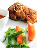 stock photo of ayam  - Javanese fried chicken named ayam kalasan focus on raw vegetables - JPG