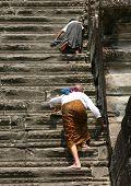 Pilgrims climbing a stairway at Angkor Wat, Cambodia