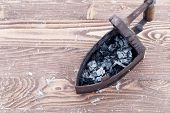 Ancient Iron Iron For Ironing Coals. Iron. On Wooden Background. poster