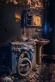 Burnt House Interior. Burned Burnt Bathroom, Fused Remains Of Furniture And Washing Machine. poster