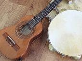 Close-up Of Two Brazilian Musical Instruments: Cavaquinho (small Acoustic Guitar) And Pandeiro (tamb poster