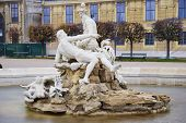foto of schoenbrunn  - Snapshot over a wonderful fountain front of the main entrance of the Schoenbrunn castle in Wien - JPG