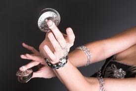 picture of belly-dance  - Belly Dancer hands holding Zagat or finger symbols - JPG