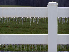 picture of white vinyl fence  - Icy white vinyl fence with green pasture in the background. ** Note: Slight blurriness, best at smaller sizes - JPG