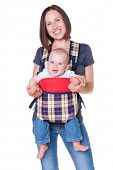 happy mother holding her baby in the knapsack. isolated on white background