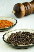 Close-up Shot Of Black Peppercorns