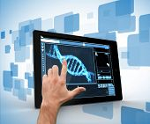 Man touching tablet pc with DNA interface on blue and white background
