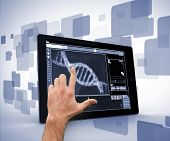Man pointing at DNA interface on digital tablet on blue and white