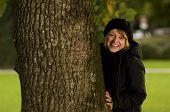 Gril Hiding Behind Tree