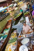 Ratchaburi, Thailand - Nov 30: A Woman Makes Thai Food At Damnoen Saduak Floating Market On November
