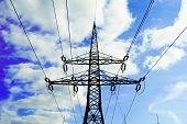 Electricity Pylon Against Blue Cloudy Sky