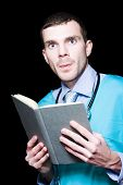 Serious Doctor Holding Medical Research Book