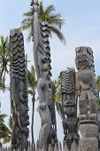 stock photo of tiki  - Tiki statues at Puuhonua O Honaunau national historical park on the big island of Hawaii - JPG
