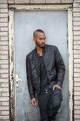 Attractive Young Black Man Standing In Door Way