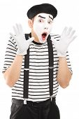 Male mime artist gesturing with his hands excitement, isolated on white background