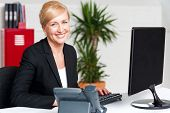 Smiling Corporate Woman Typing On Keyboard