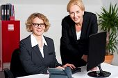Woman Working In Office With Colleague