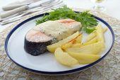 Baked salmon with potato, mustard sauce, and mizuna