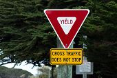 stock photo of traffic rules  - Yield Sign Cross Traffic Does Not Stop Road Sign