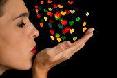 Woman Blow Heart Shape Bokeh Spots Off Her Hand