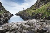 Rocky Coastline And Lighthouse, Northen Ireland