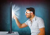 Man Wearing 3D Glasses Touches The Tv