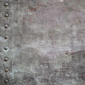 foto of stelles  - Black grunge metal plate or armour texture with rivets as background - JPG