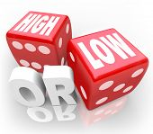The words High or Low on two red dice to illustrate a guessing game or gambling to wager on minimum