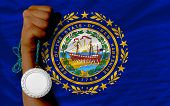 Silver Medal For Sport And  Flag Of American State Of New Hampshire