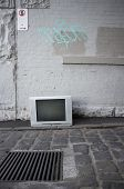 stock photo of graff  - TV discarded in the street - JPG