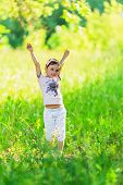 Young Girl Throwing Her Arms Up