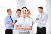 image of seminar  - picture of smiling attractive businesswoman in office - JPG