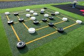 picture of draught-board  - Colorful street outdoors draughts checkers board game in a playground - JPG