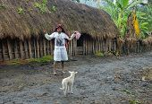Papuan Woman In The Modern White Clothes